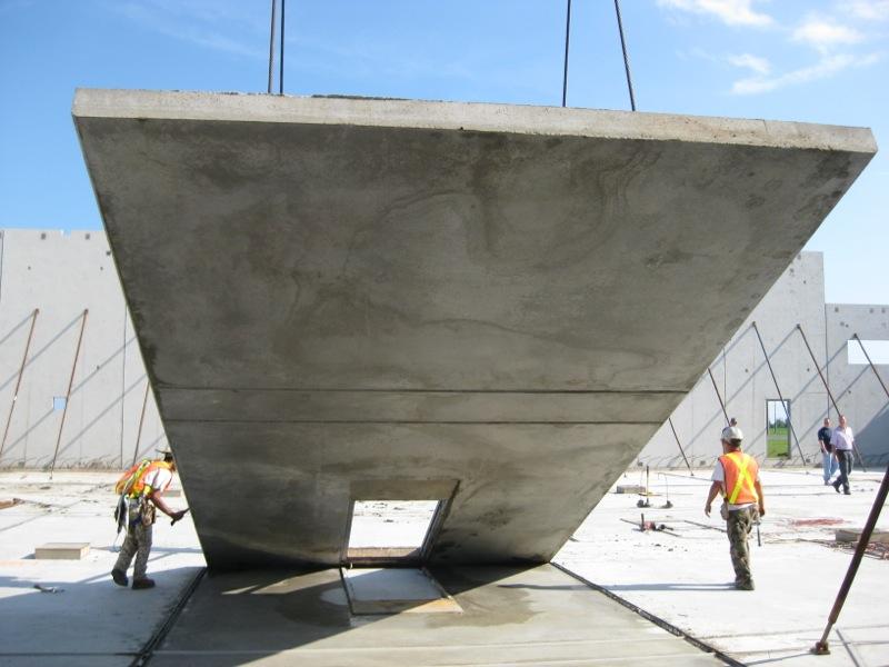 Algoma Tilt-Up Building Construction - crane pulling wall up